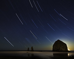 East Winds II (Ben Canales) Tags: ocean longexposure moon beach rock night oregon stars star coast twilight pacific horizon nighttime shore haystack cannon pacificnorthwest oregoncoast nautical cannonbeach haystackrock monolith starry ecola startrails seastack startrail noctography bencanales thestartrail