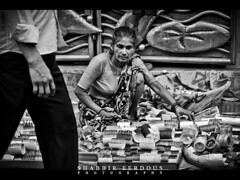 Old Footpath Seller (Shabbir Ferdous) Tags: old people bw white black lady photographer footpath bangladesh seller bangles bangladeshi dhakauniversity ef50mmf14usm shabbirferdous canoneos1dmarkiv wwwshabbirferdouscom shabbirferdouscom