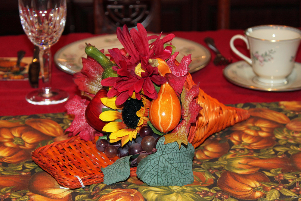 Traditional Thanksgiving Cornucopia basket with artificial fruit and gourds