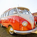 A red and white VW Camper.