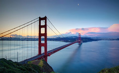 Golden Gate Moon (Jim Boud) Tags: sanfrancisco california travel bridge pink blue red moon seascape green skyline clouds sunrise landscape dawn bay skyscrapers pastel marin pacificocean goldengatebridge bayarea hdr highdynamicrange crescentmoon waterscape artisticphotography smoothwater jimboud canoneos60d exposurefusion jamesboud canon1585mmisusm
