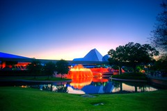 Fountains of fire make for an alight night (Imagination pavillion - Epcot) (ohhector) Tags: world city trees light sunset red sky orange lake green fountain grass high fight orlando epcot pond experimental dynamic sundown center disney journey prototype captain vista imagination monorail tomorrow walt range hdr pavillion buena eo