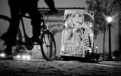 Nights Off, Champs-lyses - Paris (adde adesokan) Tags: street travel blackandwhite white black paris france bus bike night pen advertising photography frankreich nacht bokeh guess candid streetphotography olympus tires biker 20mm werbung schwarzweiss weiss schwarz fahrrad triumphbogen ep1 champslyses reifen archdetriomphe streetphotographer placecharlesdegaulle m43 mft mirrorless siriusmo microfourthirds theblackstar mirrorlesscamera streettogs nighsoff