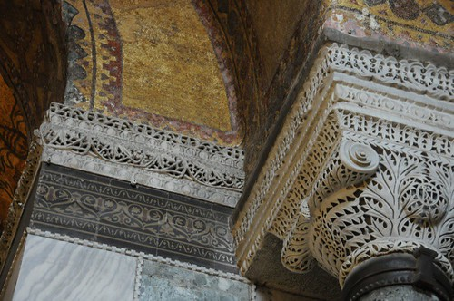 Carved capital and moulding with mosaic above