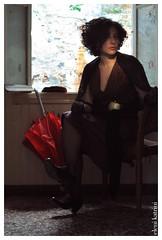 waiting (el-kat) Tags: woman window umbrela