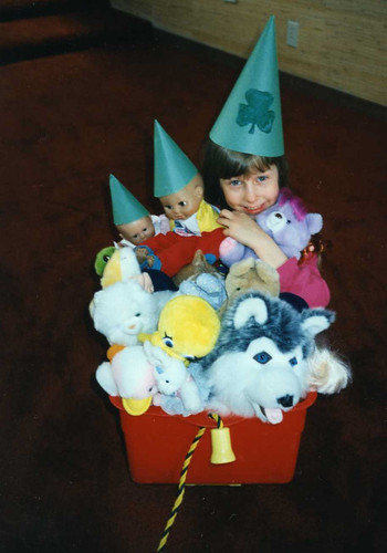 Christina (almost 6) with her St. Patrick's Day parade and party for her dolls and stuffed animals, 1996.