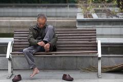 gotta stay trim and clean (skimvision) Tags: china man bench hongkong asia clip 香港 toenail 中國 亞洲