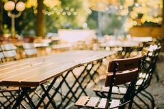 Biergarten in Early Autumn (freyavev) Tags: biergarten beergarden tables chairs bokeh niftyfifty mikasniftyfifty autumn stuttgart badcannstatt badenwürttemberg germany deutschland vsco