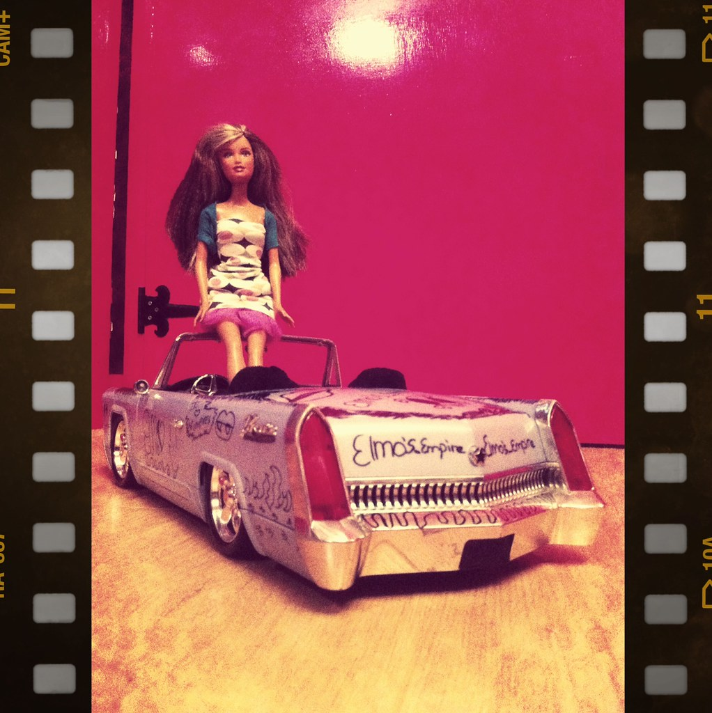 Barbie in her new car