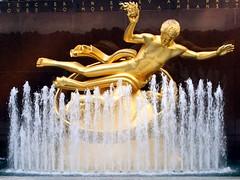 new york gold (kexi) Tags: nyc sculpture usa ny newyork water fountain statue america canon gold us october manhattan text rockefellercenter 2009 prometheus instantfave kartpostal