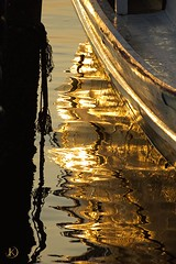 Gold Lines (Chrisseee) Tags: morning travel sun abstract reflection water lines silhouette sunrise canon thailand golden harbor pier boat asia ripple curves sigma wave rope saladan flickraward canon550d mygearandme kristiinahillerstrm mygearandmepremium chrisseee mygearandmebronze mygearandmesilver