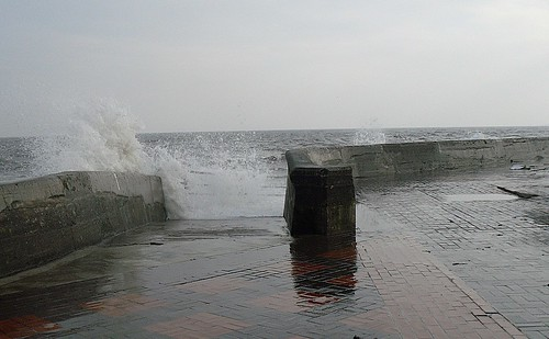 Sea surging up steps