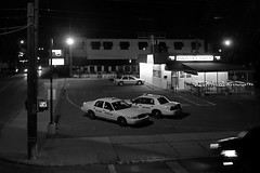 Nighthawks (tim.perdue) Tags: street shadow ohio bw white black reflection window glass sign yellow corner lights cafe traffic walk cab taxi side parking lot utility headlights pole pizza dont third intersection grandview pizzeria avenue heights nighthawks 4444444 panzeras