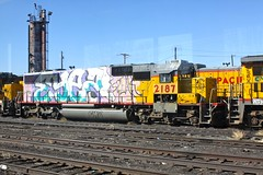 SD 60 UP 2187 at Denver (dangaken) Tags: old railroad pink urban up canon graffiti march spring rust colorado paint grafiti rusty denver tagged vandalism co unionpacific spraypaint railyard deadline denverco lodo downtowndenver uprr 2011 sd60 50d lowerdowntown canon50d gaken march2011 retiredlocomotive dangaken up2187 dgaken wwwflickrcomdgaken