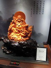 coral gemstone buddha carving