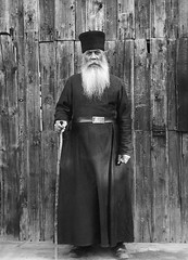 Priest, Valamo Monastery, Karelia, Russia (Swedish National Heritage Board) Tags: cane standing beard outdoors thirties 1930s robe monastery older stick priest karelia cassock riksantikvariembetet skufia theswedishnationalheritageboard