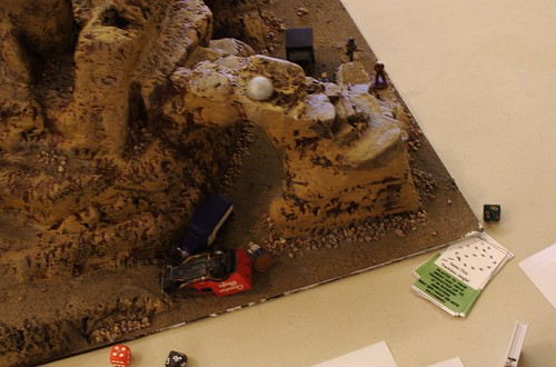 The White Russians spectacularly crash their vehicle as they race up the mesa in part two.