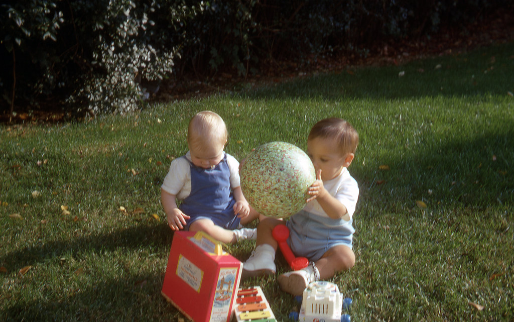 Tommy and James Casey playing with toys