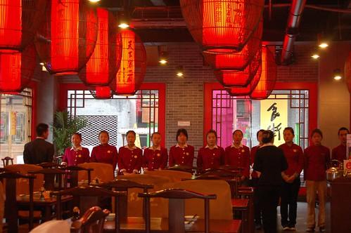 Gesang zum Arbeitsanfang im lange Nudel Restaurant Xi'an