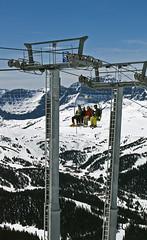 Riding Goat's Eye Over Village (DCZwick) Tags: winter snow canada ski mountains tower sunshine skilift alberta banff rockymountains skier chairlift banffnationalpark sunshinevillage themonarch goatseye TGAM:photodesk=height
