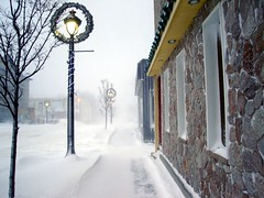Snow squalls & decorated street lamps (inspired_view) Tags: christmas winter snow ontario canada building stone streetlamp perspective sidewalk wreaths vanishing stonebuilding brucecounty squalls squal snowsqualls fotocompetition fotocompetitionbronze fotocompetitionsilver