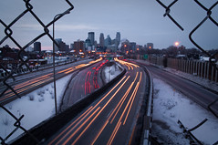 Day 25 of 265 (1-25-11) (jasonhedlund) Tags: city longexposure bridge winter snow jason cold slr cars ice minnesota skyline architecture night digital fence buildings project lens photography lights highway downtown cityscape skyscrapers hole dusk minneapolis overpass overcast vehicles photograph 200 freeway interstate lighttrails 365 twincities dslr 18 tamron mn 18200 i35 singlelensreflex 35w 24thstreet pedestrianbridge hedlund cartrails 2011 18200mm project365 tamron18200mm tamron18200 i35w nikond90 jasonhedlund hedl0071