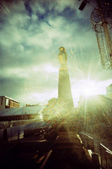 Atomic Owl (Back, and to the left) Tags: film analog gold lomo xpro crossprocessed yorkshire leeds lofi slide icerink plasticfantastic lensflare creativecommons owl expired vignetting vivi e6 milleniumsquare colorshift velvia50 plasticlens c41 colourshift ultrawideandslim vivitaruws flickr:user=backandtotheleft tumblr:user=thediaryofadisappointingman
