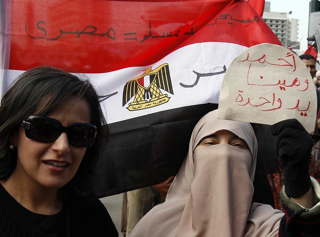 Coptic Christian and Muslim Women Protest at Tahrir Square in Front of Egyptian Flag