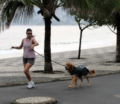 Jogger with her Dog () Tags: ocean street brazil vacation woman dog holiday praia latinamerica southamerica wet girl brasil goldenretriever walking mar calle surf waves chica cidademaravilhosa exercise surfer candid streetphotography corso running brasilien paparazzi garota mulheres leash frau avenue jogging runner mujeres fille rtw atlanticocean jogger ipanema vacanze leblon brsil roundtheworld guanabara beachscene amricadosul globetrotter southernhemisphere walkingthedog zonasul baadaguanabara ipanemabeach riobeach sundaystroll oceanoatlantico  worldtraveler southatlanticocean streetclosed repblicafederativadobrasil  americadelsud  marvelouscity   avdelfimmoreira republicofbrazil federativadobrasil avfranciscobhering