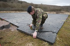 Soldier Laying RolaTrack Portable Flooring System (Defence Images) Tags: uk man male wales soldier army military equipment british flooring defense defence personnel identifiable fobex rolatrack caerwenttrgarea