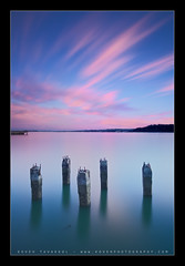 Big Stopper (Koveh Photography) Tags: ocean sf sanfrancisco california longexposure pink sea sky usa seascape reflection clouds sunrise canon landscape eos bay coast pier highway cityscape unitedstates pacific shoreline coastal filter shore baybridge bayarea pilings hitech cloudscapes 1635 morningglow landscapephotography gnd smoothwater oceanscape ef1635 cloudstreaks 5dmkii bigstopper leebigstopper kovehphotography koveh