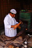 0173 Dubai, UAE (Traveling Man – Traveling, back soon) Tags: coffee hammer canon fire iron dubai uae pot arab blacksmith forge unitedarabemirates persiangulf canonef28135mmf3556isusm heritagevillage 50d southwestasia arabianpeninsula alshindagha canoneos50d markaveritt traditionalblacksmith