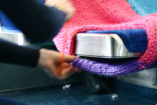 Ishkits puts the finishing touches on a SEPTA seat cozy.