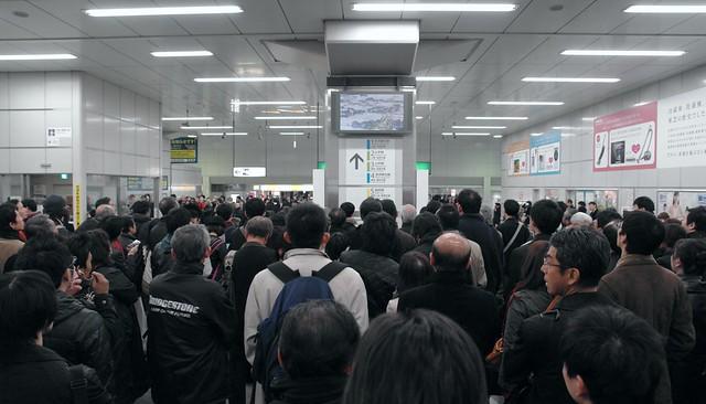 JR Akihabara station : people see TV news about earthquake