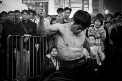 Power of human body.... (van*yuen) Tags: blackandwhite bw hongkong documentary summicron mongkok citysnap 352 shotwideopen gf2 summicron352asph