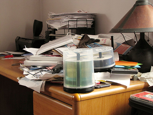 Project Simplify week 2 - Paper cluttered desk before