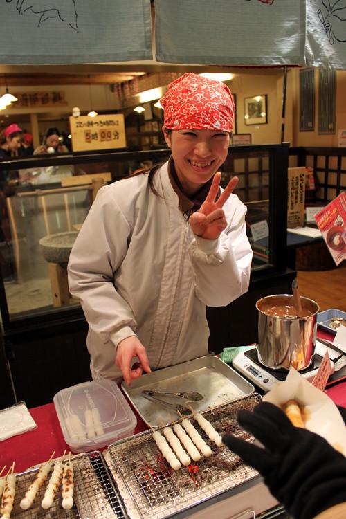 Friendly lady selling Mitarashi dango at Nikishi Market