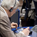 An MEP during the Development Committee meeting takes notes on his ipad