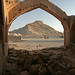 Tower of Silence at Dakhmeh-ye Zartoshtiyun through arch