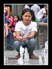 Watching on (Aktiv Phil) Tags: woman water fountain girl lady candid philippines manila greenbelt filipina makati observing