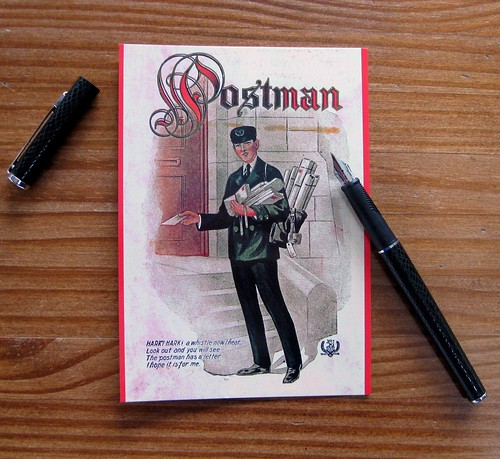 Postman postcard front with pen