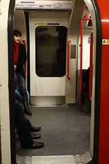 Eye (Che-burashka) Tags: street portrait london eye feet girl underground subway poster carriage transport tube commute canonef28mmf18usm