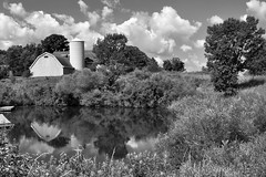 Barn Reflections in B&W (Seth Oliver Photographic Art) Tags: reflections landscapes illinois nikon midwest barns beautifulclouds pinoy blackandwhites monochromes naturescapes bwconversion d90 mchenrycounty wetreflections northernillinois handheldshot monotones barnreflections aperturef90 summerinillinois voloillinois setholiver1 18105mmnikkorlens circularpolarizers volobogvisitorcenter 0008secondexposure volobogstateandnaturearea