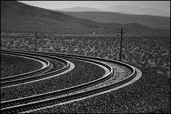 The Curve At Ludlow (greenthumb_38) Tags: railroad blackandwhite bw train blackwhite canon300d tracks ludlow mojave duotone 75300mm mojavedesert notrain canoneosdigitalrebel transcom jeffreybass