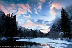 Winter Sunset on the Merced River (Yosemite National Park) (Robin Black Photography) Tags: california pink winter sunset snow color reflection landscape nationalpark rocks purple cathedral ngc valley yosemite granite yosemitenationalpark naturalwonder nationaltreasure naturesbest nationalgeographic mercedriver swingingbridge outdoorphotographer cloudsstormssunsetssunrises
