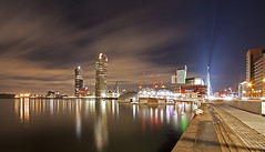 Rijnhaven Rotterdam - Revised (DolliaSH) Tags: city longexposure light people urban haven streets holland color water colors skyline architecture night canon reflections river photography lights noche photo rotterdam topf50 europe foto nightshot photos nacht harbour nederland thenetherlands wideangle le montevideo maas topf100 ultrawide nuit kopvanzuid 1022mm notte stad 1022 architectuur erasmusbrug noch zuidholland canonefs1022mmf3545usm rotjeknor rotterdamzuid southholland 50d luxortheater rijnhaven nachtopname manhattanaandemaas visitholland canoneos50d floatingpavilion dollia dollias sheombar dolliash drijvendpaviljoen anmazingnetherlands