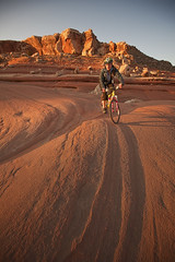 Mountain biking in Utah (Scott Spiker) Tags: scottspikerphoto naturalpatterns desertlandscape slickrockriding mountainbiking moab utah adventure dusk morning outdoors sandstone colorimage wildernessarea photography aridclimate dry extremeterrain naturallandmark sun ruggedsports scenicoverview oneperson female vacation physicalfitness recreation solitude southwestunitedstates bicycle naturalworld northamerica vertical