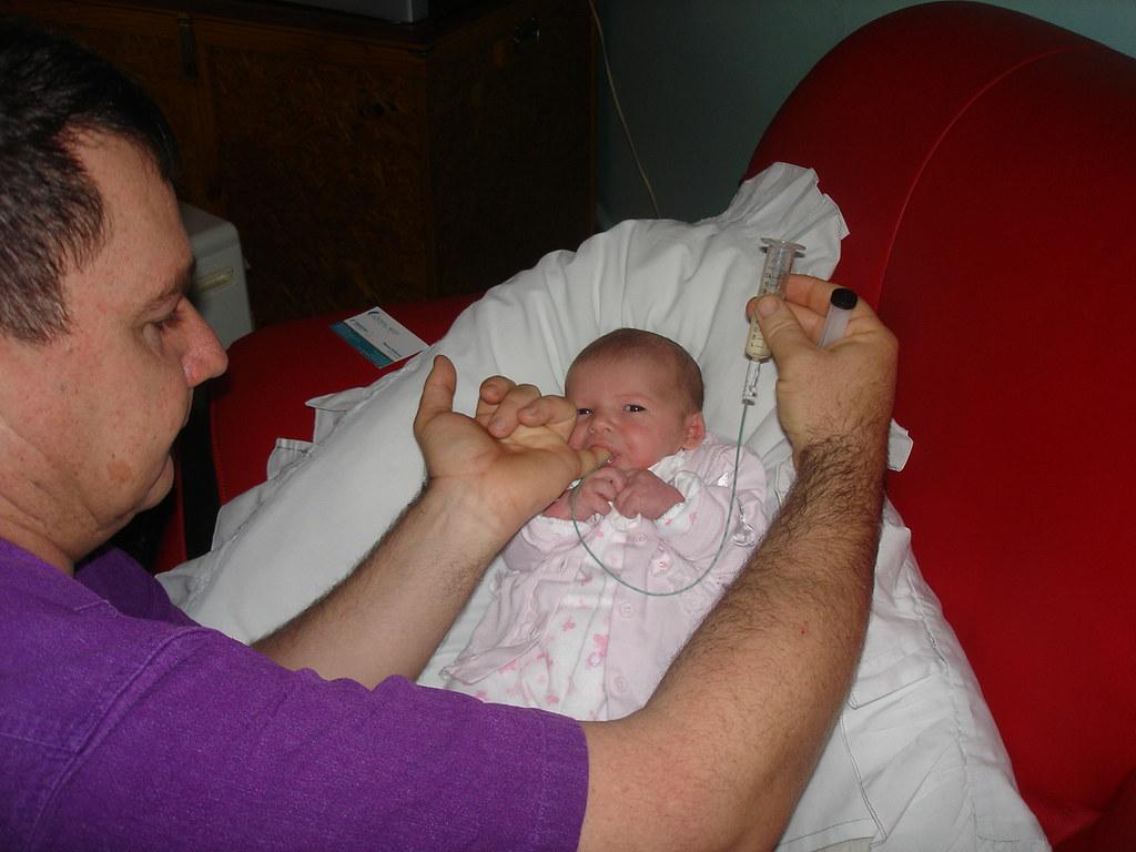 Finger feeding baby Ava