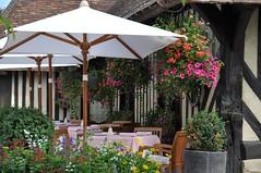 Beuvron-en-Auge (sylviedjinn 14) Tags: fleurs restaurant 14 parasol tables paysdauge calvados chaises beuvronenauge plusbeauxvillagesdefrance