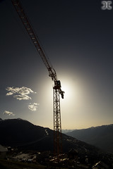 Crane (JoshJackson84) Tags: light sun france mountains alps building construction europe crane alpine valley chalet savoie 73 lesarcs paradiski vallandry canon60d